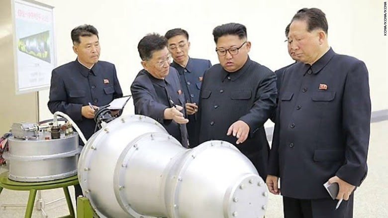 crazy kim jung un stares at a bomb - his actions may be derailing the Trump Trade