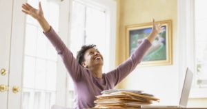 lady holding arms up happy to be debt free