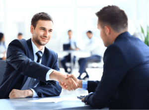 Two gentlemen shaking hands apparently in closing a business deal. TeamWork Makes DreamWork.