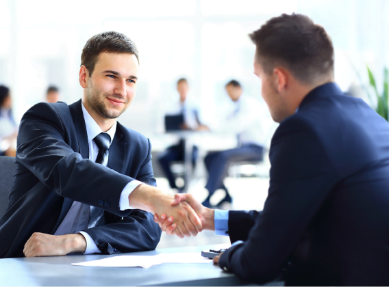 "Two gentlemen shaking hands apparently in closing a business deal. TeamWork Makes DreamWork. ""TeamWork Makes DreamWork"""