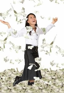 Picture of a woman in raining money. It is suggested that she just withdrew her 401k.